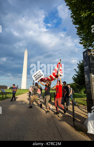 WASHINGTON, DC - September 16, 2017: Fans of the music group 'Insane Clown Posse,' called Juggalos, march in front - Stock Photo