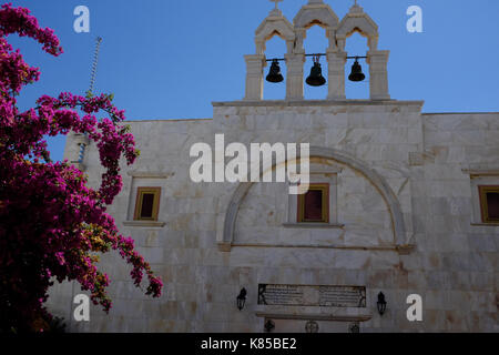 The Monastery of Panagia Tourliani in Mykonos, Greece.  People light candles for dead loved ones, interior and exterior - Stock Photo