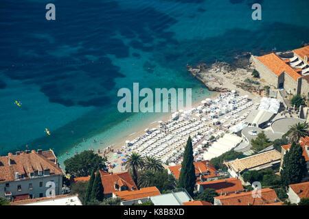 DUBROVNIK, CROATIA - JULY 19, 2017 : An aerial view of the Banje beach in Dubrovnik, Croatia. - Stock Photo