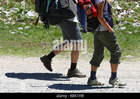 French alps. mont blanc massif. walkers on a path above the chamonix valley, france. - Stock Photo