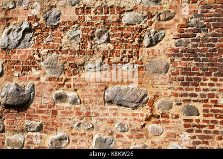 part of the wall of the old fortress, made of stones and cobbles. Photo close up - Stock Photo