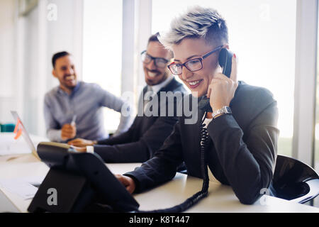 Portrait of busy female architect talking on phone - Stock Photo