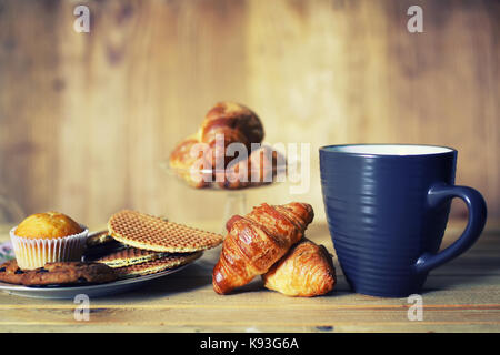 tea cup croissant breakfast - Stock Photo