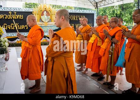 Monks, religious ceremony, in Wat Arun (Temple of Dawn), also called Wat Bangmakok Noek, Bangkok, Thailand - Stock Photo