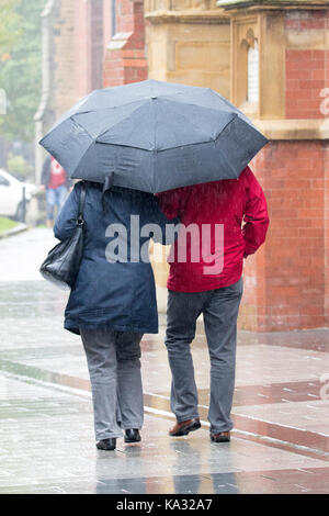 Southport, Merseyside, Heavy Rain in Southport. 25th September 2017. UK Weather.  Brollies at the ready as the heavens - Stock Photo