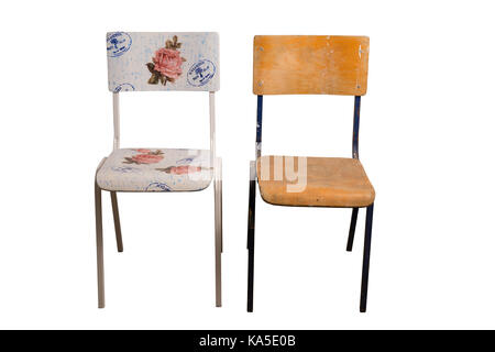 Old school chair decorated with decoupage technique and an old shabby classroom chair that is not yet decorated. - Stock Photo