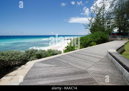 Richard Haynes Boardwalk running along Hastings Beach on the west coast of Barbados - Stock Photo