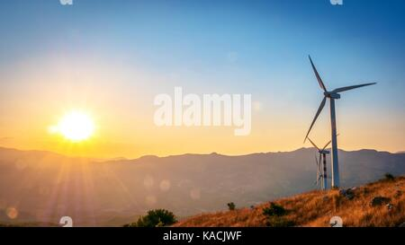 wind turbine at sunset - Stock Photo