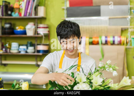 Portrait of smiling flower shop owner working. Small business. - Stock Photo