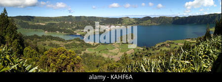 Panoramic view of the volcanic crater Caldeira das Sete Cidades and the volcanic lakes Lagoa Azul and Lagoa Verde - Stock Photo