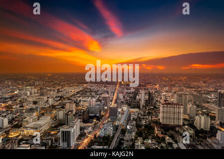 Colorful cityscape in sunset light. Bangkok, Thailand. Aerial view. Dramatic and picturesque evening scene. - Stock Photo