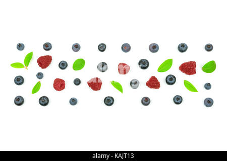 Top view of a forest fruits ornament with blueberry, leaves and a raspberry. - Stock Photo