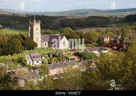 View over St Nicholas Parish Church in Montgomery and the Shropshire Hills on the Welsh border - Stock Photo