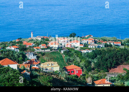 Photo taken in São Jorge Island of Madeira, on the site of the Farrobo with the lighthouse in the background. - Stock Photo