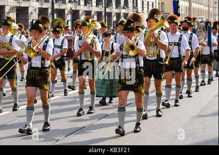 traditional costume parade at the beginning of Oktoberfest in 2012, band Burgberg, - Stock Photo
