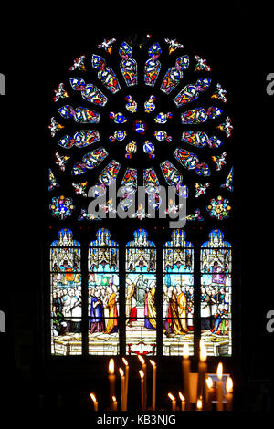 France, Finistere, Le Folgoet, Notre Dame du Folgoet basilica, stained glass of the Cross chapell - Stock Photo