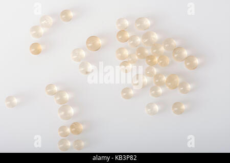 Loose silica gel beads scattered on white. - Stock Photo