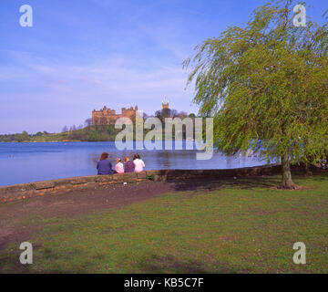 Early springtime view from the shore of Linlithgow Loch, with distant Linlithgow Palace in view, Linlithgow, Midlothian - Stock Photo