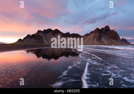 View of the mountains of Vestrahorn from black volcanic sand beach at sunset, Stokksnes, South Iceland, Polar Regions - Stock Photo