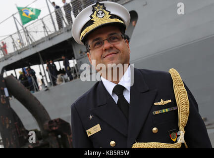 Brazilian military attache Marzone Affonso Rego Gavino stands on the pier in front of the Brazilian training vvessel - Stock Photo