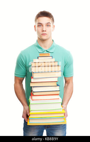 Portrait of surprised student holding big stack of books isolated on white background - Stock Photo