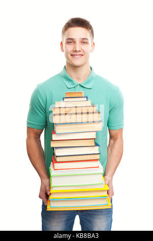 Portrait of happy smiling student holding big stack of books isolated on white background - Stock Photo