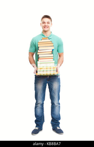 Full length portrait of happy smiling student holding big stack of books isolated on white background - Stock Photo