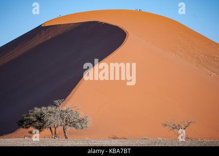 People climbing Dune 45, Sossusvlei, Namibia - Stock Photo