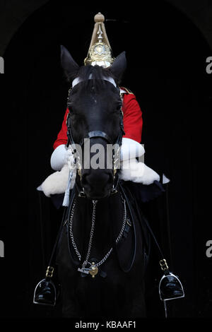 Royal Horse Guard sitting on horse back outside Horse Guards Museum, Whitehall, London - Stock Photo