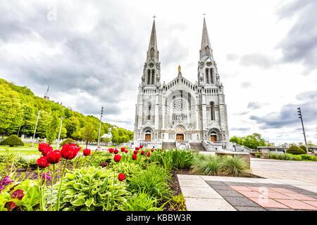 Sainte-Anne-de-Beaupre, Canada - June 2, 2017: Exterior stone architecture of Basilica of Sainte Anne de Beaupre - Stock Photo