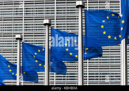 Flags of the European Union in front of the Berlaymont building in Brussels, Belgium. - Stock Photo