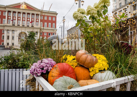 A cart with flowers and pumpkins is on Tverskaya Street in Moscow during the Moscow Autumn Festival, Russia - Stock Photo