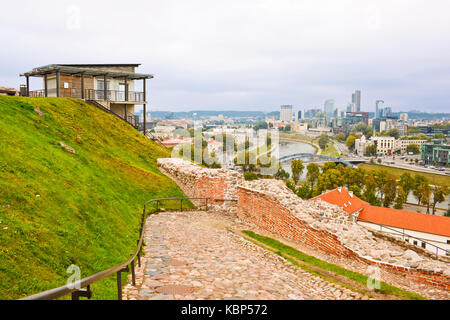View from Gediminas hill in Vilnius. A building of funicular station on the hill. Modern office buildings over the - Stock Photo