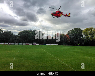 Woodford Green, London, UK. 30th September 2017. London's  Air Ambulance helicopter G-LNDN leaves Woodford Rugby - Stock Photo