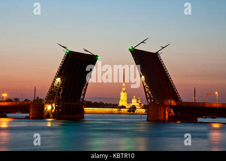 View on the Peter and Paul fortress and  raised Palace bridge in summer white nights, St. Petersburg - Stock Photo