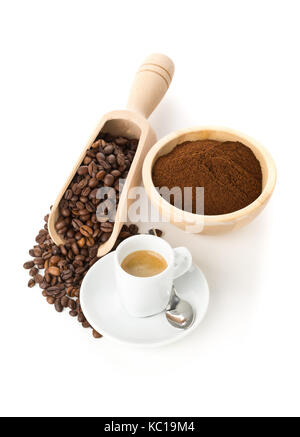 Ground coffee, coffee beans in wooden scoop and cup of espresso on white background - Stock Photo