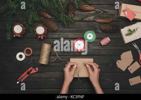 woman decorating christmas gift - Stock Photo