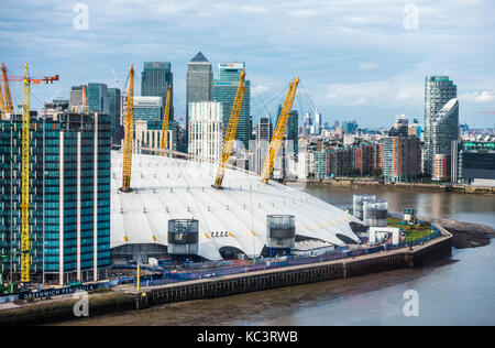 The 02 Arena on the Greenwich Peninsular development, with other iconic city skyscraper buildings behind. South - Stock Photo