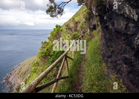Hiking trail on the south coast near Faja de Lopo Vaz, island of Flores, Azores, Portugal - Stock Photo