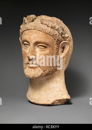 Terracotta head of a man wearing a wreath, ca. 400–310 B.C - Stock Photo