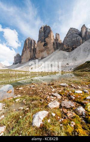 Northern walls of the Three Peaks of Lavaredo, Lake near Col Forcellina, Sesto Dolomites, South Tyrol, Trentino - Stock Photo