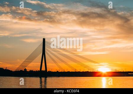 Riga, Latvia. Scenic View Of Vansu Cable-Stayed Bridge Over The Daugava River, Western Dvina In Bright Sunset Or - Stock Photo