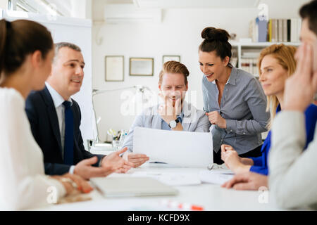 Business people having a board meeting - Stock Photo