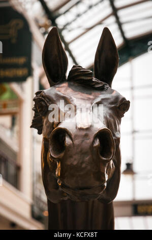 Bronze statue of the Grand National winner 'Red Rum' in Wayfarers Arcade, Southport, Lancashire,England. - Stock Photo
