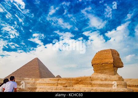 Admiring the sphinx in Cairo, Egypt - Stock Photo