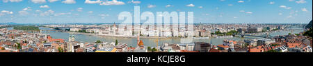 A 7 picture stitch panoramic aerial cityscape view of the Danube River in Budapest on a sunny day and blue sky. - Stock Photo