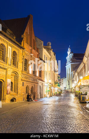Vilnius, Lithuania - July 8, 2016: Illuminated Facades Of Ancient Buildings On Famous Pilies Street Of Old Town - Stock Photo