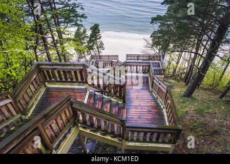 View from the top of wooden stairs on Baltic Sea beach in Miedzyzdroje seaside resort on Wolin Island in West Pomeranian - Stock Photo