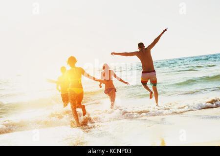 Happy friends sea beach holidays - Stock Photo