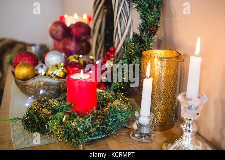 Christmas decoration on wooden table at home during christmas time - Stock Photo